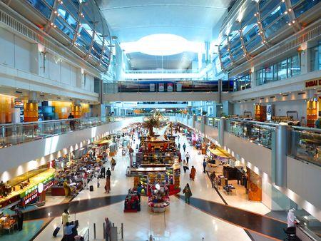 shopping trip: DUBAI, UAE - OCTOBER 08: Travellers at Dubai International Airport Terminal 1 October 08, 2010 in Dubai, United Arab Emirates. Dubai Airport is one of the worlds busiest airport.