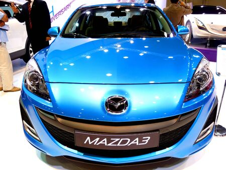 ABU DHABI, UAE - DECEMBER 10:Mazda 3 on display during Abu Dhabi Int'l Motor Show 2010 at Abu Dhabi Int'l Exhibition Centre December 10, 2010 in Abu Dhabi,United Arab Emirates. Stock Photo - 9073602