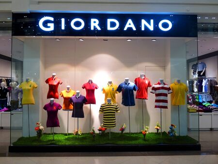 famous industries: Dubai - 3 MARCH 2011: Hong Kong Fashion Brand GIORDANO retail store in Deira City Center on 03.03.2011.