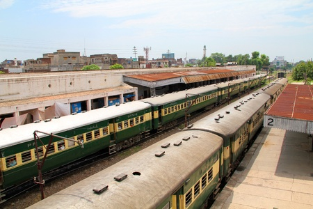 SIALKOT, PAKISTAN - AUGUST 16: Trains standing at Sialkot Railway Station, Pakistan, August 16, 2011. Railways forced to close down key routes in August, 2011 after billions of loss in the fiscal year 2010-2011. Stock Photo - 10321618