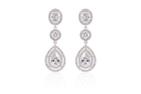 Earrings isolated, with white crystals and diamonds. Beautiful earrings on white background