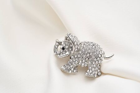 Silver brooch shaped like an elephant, with small diamonds, isolated on white background. Women Accessories