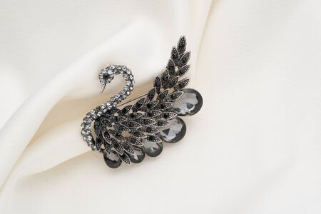 Silver brooch shaped like a swan with small diamonds, isolated on white background. Women Accessories