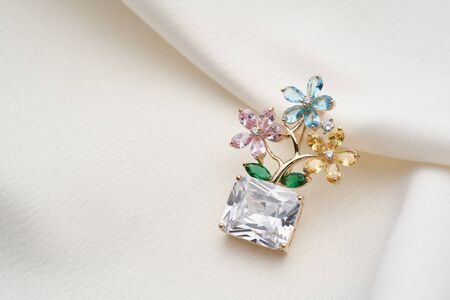 Silver brooch shaped like a tree, with small diamonds and white crystal, isolated on white background. Women Accessories