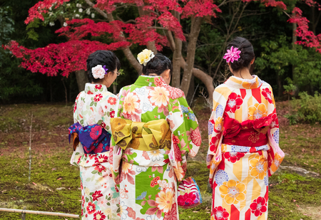 Young Japanese girls in Kimono flower watching