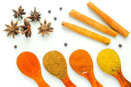 A high key flatlay closeup picture of herbs spoon with Turkish mix spices, coriander, paprika, curry, star anise, black pepper, cinnamon stick and fenugreek before marinating food. 版權商用圖片