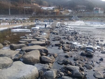 Natural stepping-stone at winter public park stream in Hwacheon city in Gangwon, South Korea.