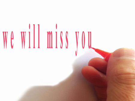 Hand writing We'll Miss You with red marker 写真素材