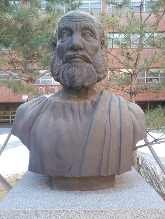 Statue of Hippocrates,ancient Greek physician in garden: Hippocrates of Kos also known as Hippocrates II, was a Greek physician of the Age of Pericles (Classical Greece), and is considered one of the most outstanding figures in the history of medicine.