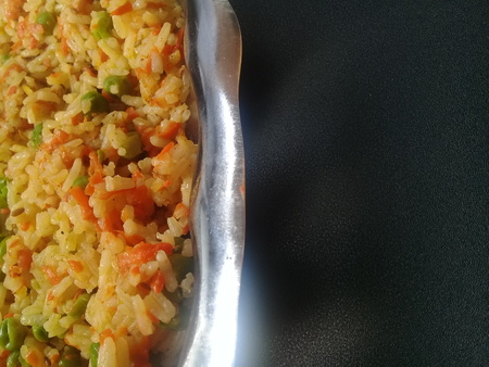 Basmati Rice Pulao or pulav with Peas, or vegetable rice using green peas also known as matar pulao with black background Imagens