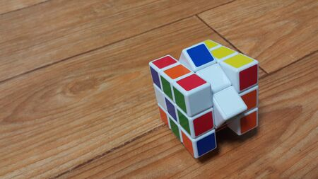 SOUTH KOREA, 08 OCTOBER-2018: Close up view of Rubik cube on wooden floor. A modern toy for mind and logical games. Stock fotó