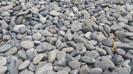 Rock Pebbles, small, rounded, smooth rocks. Texture background for text.
