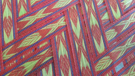 Colorful plastic woven stripes of traditional bed used in rural areas.