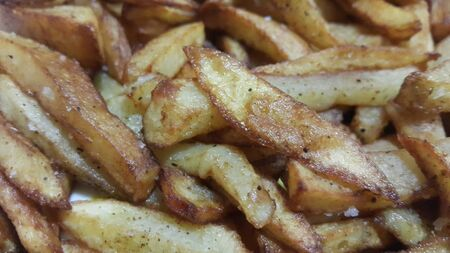 Potato fried or roasted slices on clean background with copy space for text 写真素材