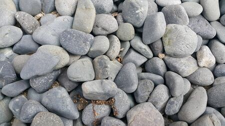 Texture background: Rock Pebbles, small, rounded, smooth pibbles with copy space for text