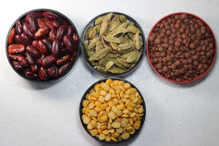 Top view of assortment of cereals, and cardamom. Collection of different spices and cereals.