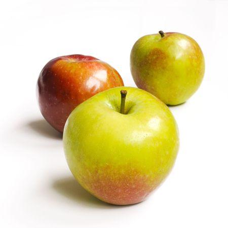 Tree fresh red-green apples on white