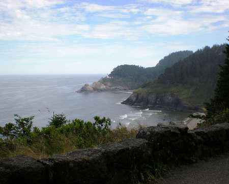 far off: view of a lighthouse far off in the distance on the Oregon coast Stock Photo