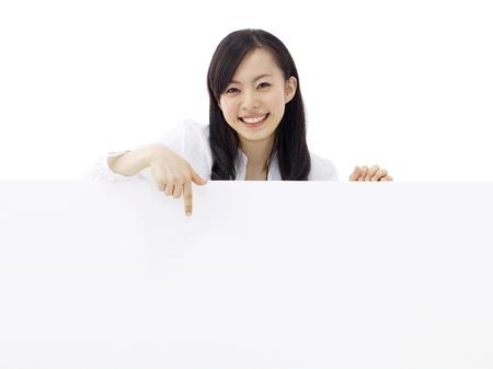 woman holding a blank billboard.