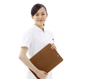 asian nurse: Smiling medical doctor or nurse. Isolated on white background
