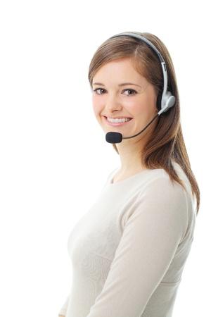 白い背景で隔離のヘッドセットで幸せの笑みを浮かべて陽気なサポート電話オペレーターの肖像画