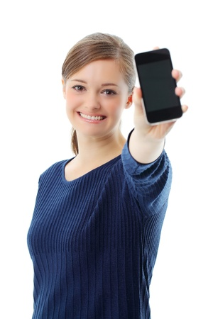 Young girl holding out mobile phone Stock Photo