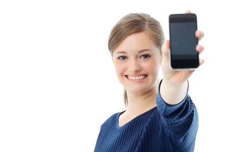 advertise with us: Young girl holding out mobile phone Stock Photo