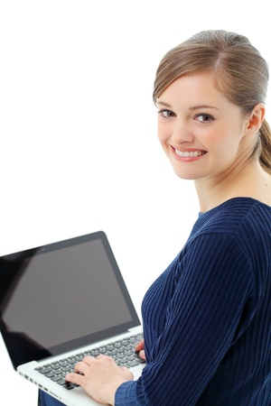 Top view of a lovely young lady using a laptop with a finger on her chin. Stock Photo - 13121919