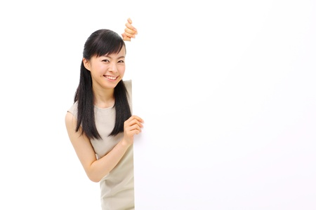 young business woman holding blank billboard, isolated on white background photo