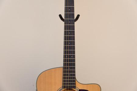 frets: frets on wooden acoustic guitar