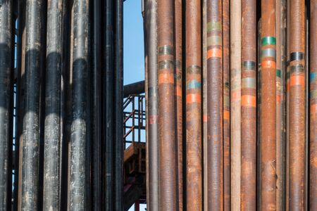 drill floor: Rusty drill pipe on the rig floor Stock Photo