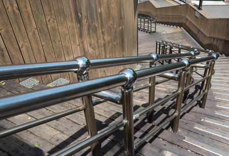 metallic stairs: stainless steel banister with wooden staircase Stock Photo