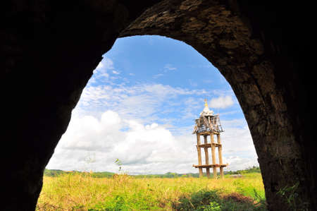 conservative: Old belfry in the field under blue sky