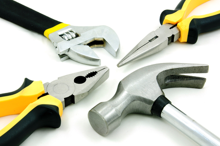 Tool kit of hammer, adjustable wrench and pliers Archivio Fotografico - 102936595