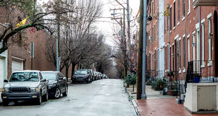 typical: Typical street in center city Philadelphia on a rainy day.  Clean and freshly looking.