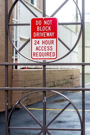 Iron door with warning. Do not block. 24 - 7.