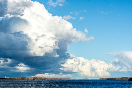 invigorating: Invigorating clouds in the winter sky over Delaware River - colorful, beautiful and gorgeous.