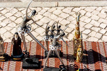 Unique antique items available on a flea market in Portugal Banco de Imagens