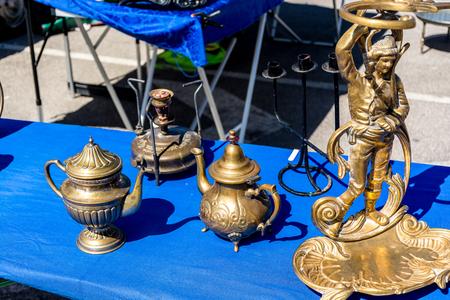 Variety of antique treasure items at Portugal market Banco de Imagens