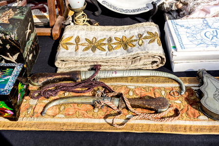 weaponry: Variety of antique treasure items at Portugal market - pirates equipment, weapons, wine bottles,