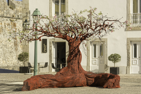 one of a kind: Red tree in a public place for visitors to enjoy and have fun