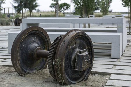 recreation area: Heavy metal wheels lost from a train and stuck at a recreation area