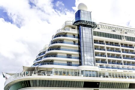 Cruise ship fragment with blue sky and clouds Banco de Imagens