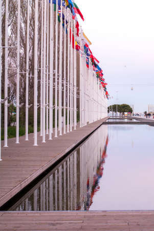 Numerous Flag poles reflected in water Banco de Imagens