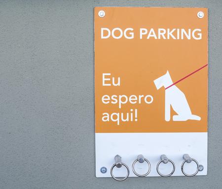 i am here: Dog Parking sign - I am waiting here - outside a supermarket