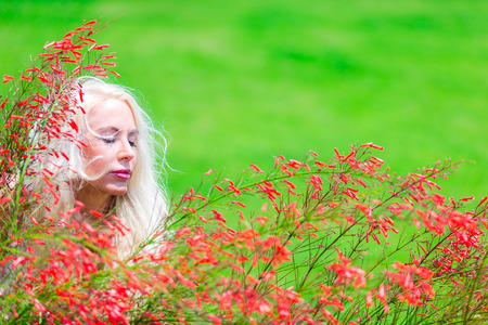Blonde woman in park Stock Photo