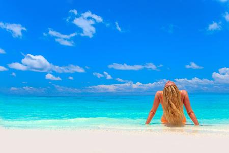 lifeline: Escape the Dreamscape with beauty girl on Maldives Stock Photo
