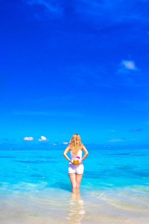 Blonde young girl with white dress in the sea Stock Photo