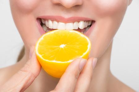 Beauty Female face with fresh lemon fruits
