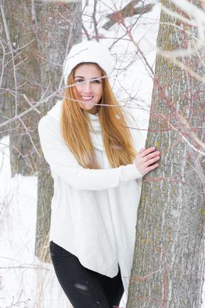 Blonde girl in the winter